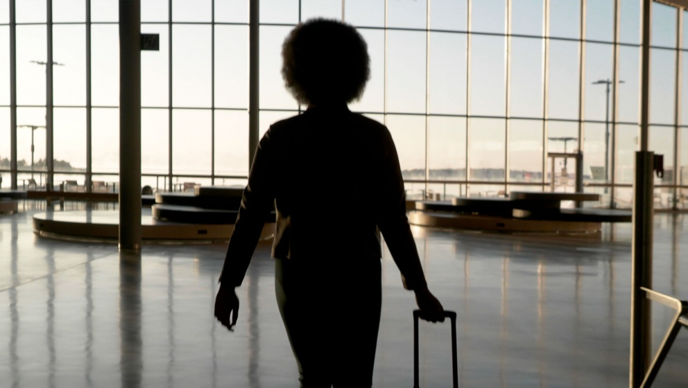 Woman in the empty flight entrance hall